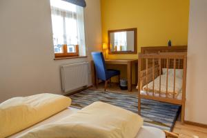 A bed or beds in a room at Penzion u Pejtrika