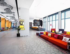 The lobby or reception area at Hampton by Hilton Dubai Al Seef