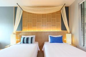 سرير أو أسرّة في غرفة في CRAFT Resort & Villas