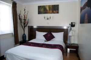 A bed or beds in a room at Villaggio