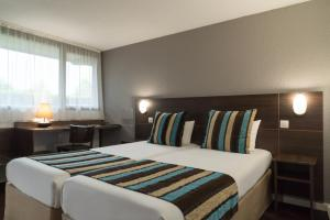 A bed or beds in a room at Sure Hotel by Best Western Biarritz Aeroport