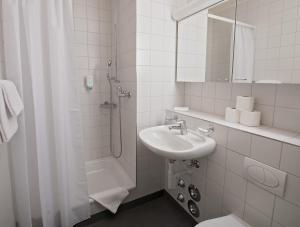 Ein Badezimmer in der Unterkunft Apaliving - Budgethotel
