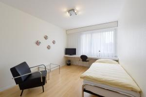 Ein Bett oder Betten in einem Zimmer der Unterkunft Apaliving - Budgethotel