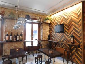 The lounge or bar area at Hospedium Hotel Boutique Cañitas SPA.