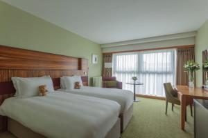 Un ou plusieurs lits dans un hébergement de l'établissement Radisson BLU Hotel & Spa, Little Island Cork
