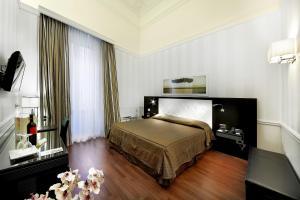 イル プリンチペ ホテル カタニアにあるベッド