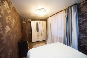 Кровать или кровати в номере Апартаменты на Шереметевском