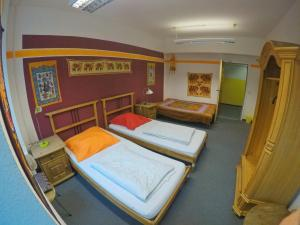 A bed or beds in a room at Black Sheep Hostel