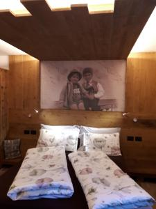 A bed or beds in a room at Majon de la nona