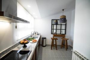 Una cocina o zona de cocina en Arco de la Villa