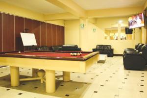 A billiards table at Hotel B&V