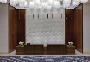 The lobby or reception area at Hilton Guadalajara Midtown
