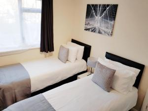 A bed or beds in a room at COGIE HOUSE