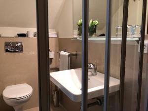 Ванная комната в Penzion Luxor