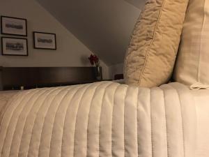 Кровать или кровати в номере Penzion Luxor