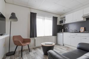 Küche/Küchenzeile in der Unterkunft De Berkenhof