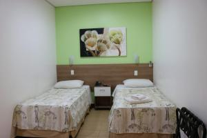Кровать или кровати в номере Hotel Oly Plaza