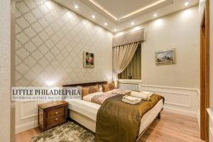Postel nebo postele na pokoji v ubytování Little Americas Premium Apts