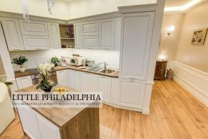 Kuchyň nebo kuchyňský kout v ubytování Little Americas Premium Apts
