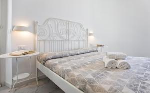 A bed or beds in a room at Ciutat Alghero