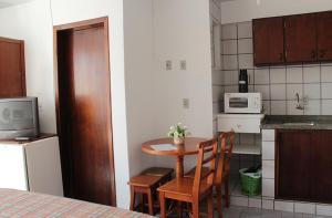 A kitchen or kitchenette at Residencial Maria Da Praia