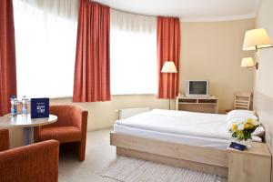 A bed or beds in a room at Kolonna Hotel Rēzekne