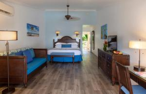A bed or beds in a room at St. James's Club Resort - All Inclusive