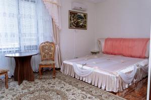 Кровать или кровати в номере Отель Эдем