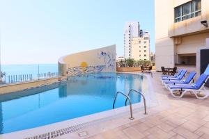 The swimming pool at or near Ramada Plaza by Wyndham Beirut Raouche