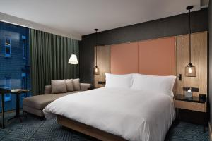 A bed or beds in a room at Hilton London Bankside