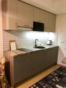 A kitchen or kitchenette at Karlson Boutique Apart Hotel