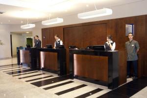 The lobby or reception area at Beach Class International - Flat