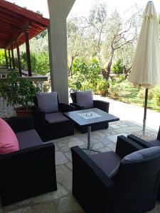 A seating area at Pelagos Beachfront