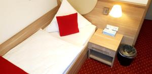 Ein Bett oder Betten in einem Zimmer der Unterkunft Aparthotel Wangener Landhaus