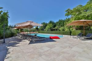The swimming pool at or near Les Carmes and spa