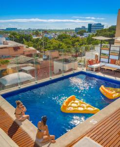 The swimming pool at or near Nomads Hotel & Rooftop Pool Cancun