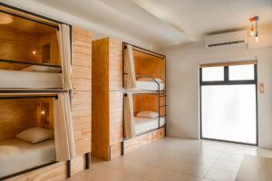 A bunk bed or bunk beds in a room at Nomads Hotel & Rooftop Pool Cancun