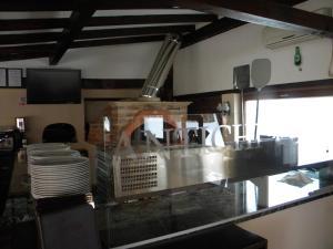 A kitchen or kitchenette at Pensiunea Mason's