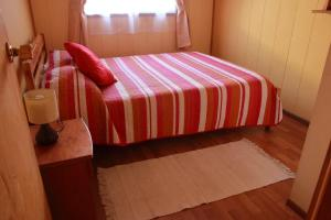 A bed or beds in a room at Cabañas Don Gaspar