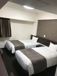 A bed or beds in a room at Hotel Musashino no Mori
