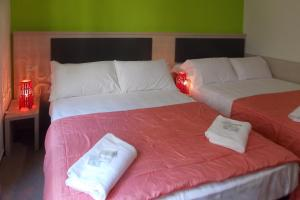 A bed or beds in a room at Hotel Midtown Milano