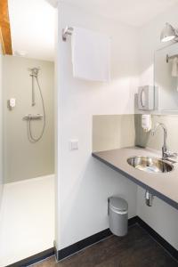 Een badkamer bij Leo BBB
