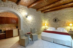 A bed or beds in a room at Casa Moazzo Suites and Apartments