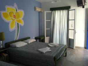 Ένα ή περισσότερα κρεβάτια σε δωμάτιο στο Πέλαγος