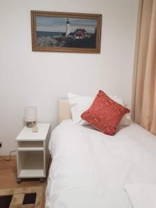 A bed or beds in a room at Forest In City Lodge