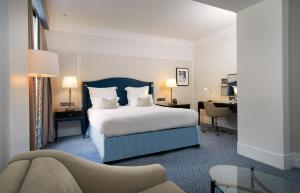 A bed or beds in a room at The Waldorf Hilton