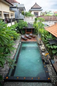 A view of the pool at Buana Home Stay by Suka Hospitality or nearby