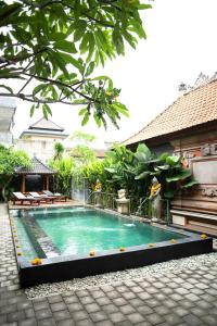 The swimming pool at or near Buana Home Stay by Suka Hospitality