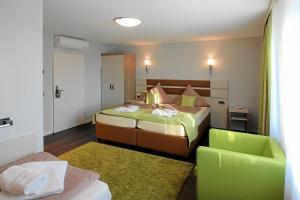 Ein Bett oder Betten in einem Zimmer der Unterkunft Hotel-Restaurant Axion