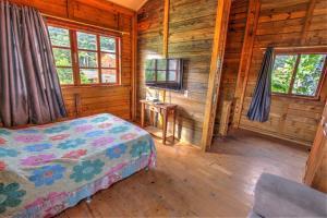 Cama ou camas em um quarto em Vila Equilíbrio Natural